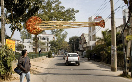 Cheesy Pizza Outdoor Ad